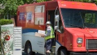 A Canada Post employee fills a community mail box in Dartmouth, N.S. on Thursday, June 30, 2016. Canada Post and the Canadian Union of Postal Workers have been in negotiations since December for its 50,000 delivery and plant employees. THE CANADIAN PRESS/Andrew Vaughan
