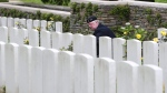 A Canadian veteran lays a wreath of flowers on a grave in the Canadian WWI monument of Beaumont Hamel, northern France, before commemorations marking the centenary of the Somme battle, Friday, July 1, 2016. More than 1 million people were killed, wounded or went missing in the Battle of the Somme in northern France, pitting British and French troops against German ones from July 1 to Nov. 18, 1916. The Canadian Royal Newfoundland Regiment took part to the battle in Beaumont Hamel. (AP Photo/Kamil Zihnioglu)