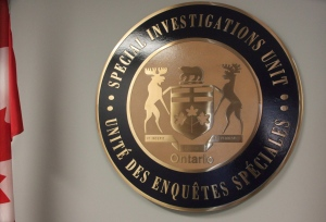 In this Sept. 27, 2013 file photo, the emblem of Ontario's Special Investigations Unit is seen in headquarters in Mississauga, Ont.. (Colin Perkel / THE CANADIAN PRESS)