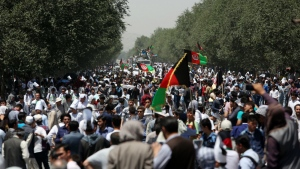 Protesters march during a massive anti-government protest in Kabul, Afghanistan on Saturday, July 23, 2016. (AP / Rahmat Gul)