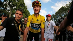 Tour de France champion, Chris Froome, wearing the overall leader's yellow jersey, after finishing the twenty-first stage of the Tour de France cycling race over 113 kilometers (70.2 miles) with start in Chantilly and finish in Paris, France, Sunday, July 24, 2016. (AP / Christophe Ena)