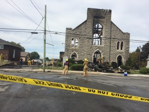 Police tape blocks access to the St. Isidore Church in St. Isidore, ON.