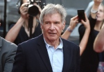 In this December 10, 2015 file photo, Harrison Ford greets fans during a Star Wars fan event in Sydney. (AP Photo/Rob Griffith, File)