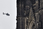 In this file photo, a police helicopter is seen flying near the the Cologne cathedral during the start of the street carnival in Cologne, Germany, on Thursday, Feb. 4, 2016. ( AP Photo/Martin Meissner