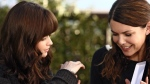 This undated publicity photo, released by The WB, shows Alexis Bledel as Rory Gilmore, left, and Lauren Graham as Lorelai Gilmore in a scene from the network's series 'Gilmore Girls.' (AP Photo/ The WB / Scott Garfield)