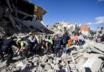 Rescuers carry a victim on a stretcher following and earthquake in Amatrice, central Italy, Wednesday, Aug. 24, 2016. (Massimo Percossi/ANSA)
