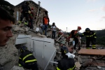 Rescuers search through debris following an earthquake in Pescara Del Tronto, Italy, Wednesday, Aug. 24, 2016. (AP Photo/Andrew Medichini)