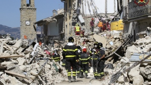 Rescuers work amid collapsed building in Amatrice, central Italy on Thursday, Aug. 25, 2016. (Italian Firefighters Vigili del Fuoco)