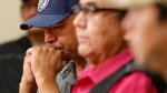 Norway House resident Leon Swanson weeps at a press conference in Winnipeg, Friday, August 26, 2016 where Manitoba's former aboriginal affairs minister Eric Robinson, centre, announced Swanson and David Tait Jr., right, were switched at birth in 1975 when their mothers gave birth at Norway House Indian Hospital. A recent DNA test revealed that the two men from Norway House Cree Nation in northern Manitoba were likely raised by each other's families. This is the second time such an incident occurred in 1975. THE CANADIAN PRESS/John Woods