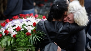Mourners hug each other during a state funeral for some of the victims of last Wednesday's earthquake, in Amatrice, central Italy, Tuesday, Aug. 30, 2016. (AP / Andrew Medichini)