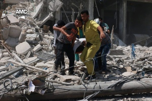 This photo provided by the Syrian anti-government activist group Aleppo Media Center (AMC), shows Syrians carrying a victim after barrel bombs were dropped on the Bab al-Nairab neighborhood in Aleppo, Syria, Saturday, Aug. 27, 2016.
