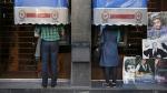 Iranians use ATM machines of Bank Melli Iran in downtown Tehran, Iran, on April 4, 2015. (Vahid Salemi / AP)