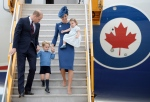 The Duke and Duchess of Cambridge, along with their children Prince George and Princess Charlotte step off the plane as they arrive in Victoria, B.C., Saturday, Sept 24, 2016. (The Canadian Press/Jonathan Hayward)