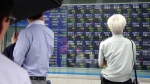 People look at an electronic stock indicator of a securities firm in Tokyo on Wednesday, Sept. 28, 2016. (AP / Shizuo Kambayashi)