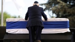 Israeli President Reuven Rivlin places his hands on the casket of former Israeli President Shimon Peres in Jerusalem, on Sept. 30, 2016. (Carolyn Kaster / AP)