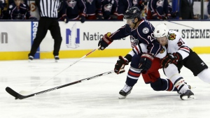 Chicago Blackhawks' Brian Campbell, right, knocks the puck away from Columbus Blue Jackets' Brandon Saad during the second period of an NHL hockey game in Columbus, Ohio on Friday, Oct. 21, 2016. (AP / Jay LaPrete)