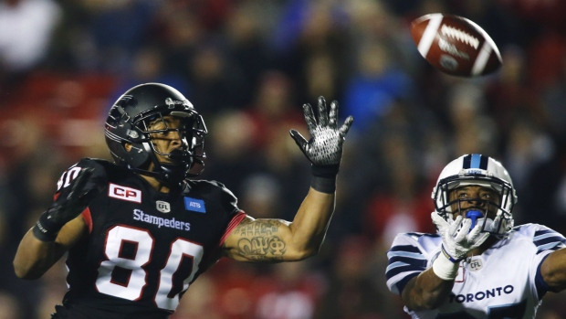 Calgary Stampeders' Jamal Nixon, left, can't make a reception as Toronto Argonauts' Marcus Alford defends during first half CFL football action in Calgary on Friday, Oct. 21, 2016. (Jeff McIntosh / THE CANADIAN PRESS)