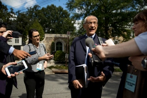 In this photo taken Oct. 5, 2016, Hillary Clinton's campaign manager John Podesta speaks to members of the media outside Democratic presidential candidate Hillary Clinton's home in Washington. (AP / Andrew Harnik)