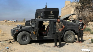 Iraq's elite counterterrorism forces are deployed in the town of Bartella, Iraq, Saturday, Oct. 22, 2016. Iraqi forces retook Bartella, around 15 kilometers (9 miles) east of Mosul, earlier this week, but are still facing pockets of resistance in the area. (AP Photo/Khalid Mohammed)