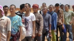 Sailors who had been held hostage by pirates for more than four years, queue to board an airplane after being released in Galkayo, Somalia Sunday, Oct. 23, 2016. (AP)