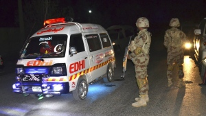 An ambulance rushes injured officers to a hospital after gunmen attacked a police training center in a suburban area of the provincial capital of Quetta, Pakistan, Tuesday, Oct. 25, 2016. (AP / Arshad Butt)