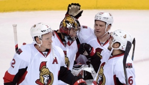 Ottawa Senators' Dion Phaneuf (2), left to right, goalie Craig Anderson (41), Chris Neil (25) and Chris Wideman (6) celebrate their victory over the Vancouver Canucks following third period NHL action in Vancouver, B.C. Tuesday, Oct. 25, 2016. (Jonathan Hayward/THE CANADIAN PRESS)