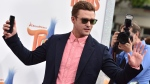 """In this Oct. 23, 2016, file photo, Justin Timberlake arrives at the Los Angeles premiere of """"Trolls.""""  (jordan Strauss/AP)"""