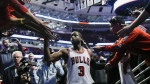 In his first game with the team, Chicago Bulls guard Dwyane Wade greets fans after an NBA basketball game against the Boston Celtics in Chicago on Thursday, Oct. 27, 2016. (AP / Matt Marton)