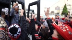 Ottawa Redblacks Jeff Richards reacts as fans cheer after the team returned to Ottawa after winning the Grey Cup against the Calgary Stampeders, on Monday, Nov. 28, 2016. THE CANADIAN PRESS/Justin Tang