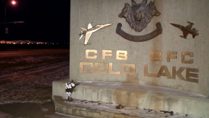 Flowers are placed near the entrance of CFB Cold Lake in memory of a pilot who died in a crash on Monday, Nov. 28, 2016.