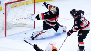 Philadelphia Flyers' Claude Giroux, bottom, blasts the game winning overtime goal past Ottawa Senators goalie Mike Condon during NHL hockey action in Ottawa on Thursday, Dec. 1, 2016. (Sean Kilpatrick/THE CANADIAN PRESS)