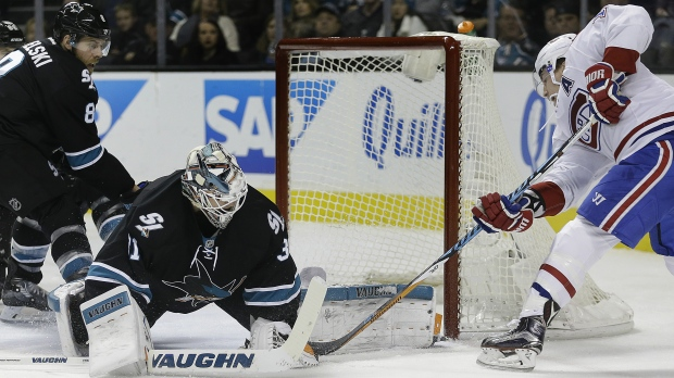 Montreal Canadiens' Brendan Gallagher, right, takes a shot against San Jose Sharks goalie Martin Jones (31) during the second period of an NHL hockey game Friday, Dec. 2, 2016, in San Jose, Calif. (AP / Ben Margot)
