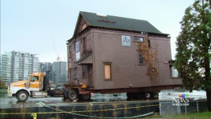 111-year home moved across city by barge