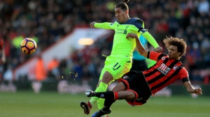 Liverpool's Roberto Firmino, left, and AFC Bournemouth's Nathan Ake during the English Premier League soccer match at the Vitality Stadium, Bournemouth, England, Sunday Dec. 4, 2016. (Adam Davy/PA via AP)