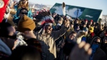 A crowd gathers in celebration at the Oceti Sakowin camp after it was announced that the U.S. Army Corps of Engineers won't grant easement for the Dakota Access oil pipeline in Cannon Ball, N.D. on Sunday, Dec. 4, 2016. (AP Photo/David Goldman)