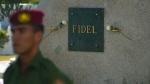A soldier of the Revolutionary Armed Forces ( FAR ) stand in guard next to the tomb of Cuba's leader Fidel Castro at the Santa Ifigenia cemetery in Santiago, Cuba, Saturday, Dec. 3, 2016. A wooden box containing Fidel Castro's ashes was placed by his brother and successor Raul on Sunday into the side of a granite boulder that has become Cuba's only official monument to the charismatic bearded rebel.(AP Photo/Ramon Espinosa)