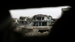 A rebel position is viewed from a Syrian army position on the Ramouseh front line, east of Aleppo, Syria on Monday, Dec. 5, 2016. (AP / Hassan Ammar)