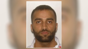 A warrant has been sought for the arrest of 32-year-old Mahmoud Kayem who has been charged with one count of accessory after the fact to murder.