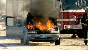 Car catches fire with family inside