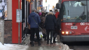 People crowd around a corner on Elgin St. to get on an OC Transpo bus. A new plan will see the sidewalks on the street widened, shrinking Elgin to just two lanes for traffic. (Jamie Karam/CTV Ottawa, January 11, 2017)