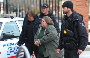 Elizabeth Wettlaufer is escorted into the courthouse in Woodstock, Ont. on Friday, Jan. 13, 2017. (THE CANADIAN PRESS/Dave Chidley)