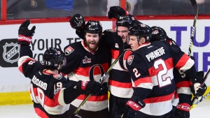 Ottawa Senators' Mark Stone (61) celebrates his goal against the Pittsburgh Penguins with teammates Derick Brassard (19), Zack Smith (15), Cody Ceci (5) and Dion Phaneuf (2) during third period NHL hockey action in Ottawa on Thursday, Jan. 12, 2017. (Sean Kilpatrick/THE CANADIAN PRESS)