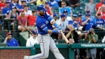 """A person with knowledge of the negotiations tells The Associated Press that outfielder Jose Bautista and the Toronto Blue Jays are """"working really hard"""" to bring him back to the club. (AP Photo/David J. Phillip, File)"""