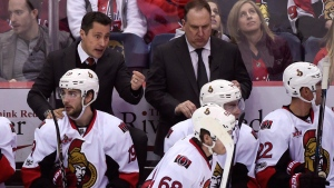 Ottawa Senators head coach Guy Boucher speaks to his players from the bench during the third period of an NHL hockey game against the Washington Capitals, Sunday, Jan. 1, 2017, in Washington. The Ottawa Senators aren't in a playoff spot at the halfway mark of the season, but considering the challenges they've faced through the first 41 games of the year they feel pretty good that won't be the case by the end of the season. (Molly Riley/THE CANADIAN PRESS/AP)