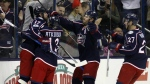 Columbus Blue Jackets forward Brandon Dubinsky, left, celebrates with teammates forward Cam Atkinson, forward Boone Jenner and defenseman Ryan Murray after his goal against the Carolina Hurricanes during the first period of an NHL hockey game in Columbus, Ohio, Tuesday, Jan. 17, 2017. (AP / Paul Vernon)
