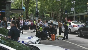 Police and emergency services gather at the scene after a car is believed to have hit pedestrians in Bourke Street Mall in Melbourne, Australia, Friday, Jan. 20, 2017. (Luke Costin / AAP)