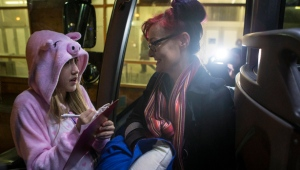 A protester is checked aboard a bus in Toronto on Friday, January 20, 2017 as they head to Washington D.C. to join tomorrow's women's march. THE CANADIAN PRESS/Chris Young