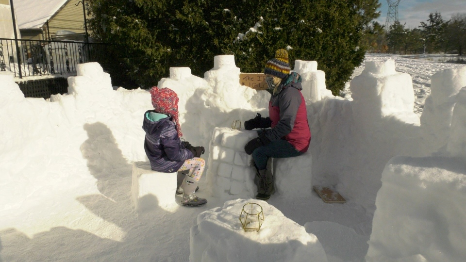 Lindsay and Rosalie Hunter in snow fort