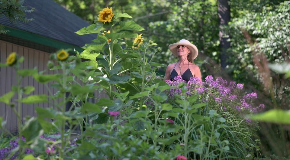 Leanne with volunteer sunflowers