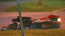 A man in his 20s was riding his motorcycle down Carling Avenue when he collided with a 16-year-old cyclist, Sunday, May 16, 2010. Image courtesy: TVA.